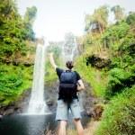 Winner near waterfall. Active life concept  — Stock Photo #47573893