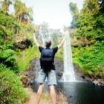 Winner near waterfall. Active life concept  — Stock Photo #47573895