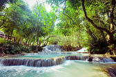 Kuangsi  waterfall in deep forest in Laos — Stock Photo