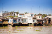 JAN 28 2014 - MY THO, VIETNAM - Houses by a river, on JAN  28, 2 — Stock Photo