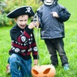 Two boys wearing halloween costumes — Stock Photo