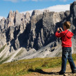 Young boy photographing mountains — Stock Photo
