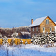 Non-urban winter landscape with wooden house — Stock Photo