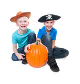 Pirate and cowboy with pumpkin - halloween theme — Stock Photo