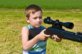 Young boy shooting — Stock Photo