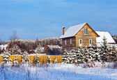 Non-urban winter landscape with wooden house — Foto de Stock