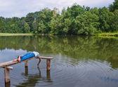Boy on the lake — Stock Photo