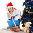 Pretty girl under christmas tree — Foto de stock #12860894