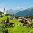 Village and chapel in Swiss Alps — Stock Photo