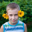 Royalty-Free Stock Photo: Boy with flowers on ears having fun