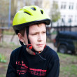 Royalty-Free Stock Photo: Serious boy wearing helmet