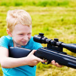 Young boy shooting — Stock Photo