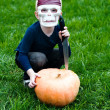 Halloween: young boy wearing skull mask — Stock Photo