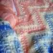 Постер, плакат: Pink white and blue crochet shawl
