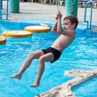 Royalty-Free Stock Photo: Young boy having fun in aquapark