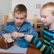 Two boys making gingerbread house — Stock Photo