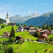 Village and chapel in Swiss Alps — Stock Photo #12866791