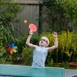 Young boy playing ping pong — Stock Photo