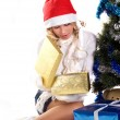Pretty girl opening christmas gift - Stock Photo