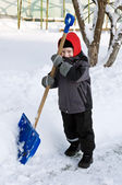 Young boy with shovel helping cleaning the snow — Stock Photo