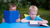 8-year and 6-year boys reading books — Foto Stock