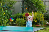 Young boy playing ping pong, motion blur — Stock Photo