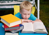 6-year boy reading book — Stock Photo
