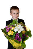 Young boy with flowers — Stock Photo