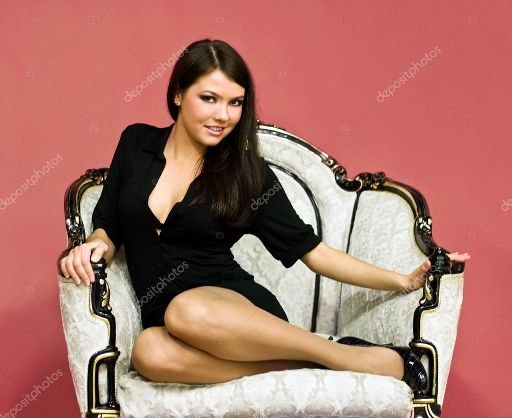 Pretty girl sitting in antique armchair stock photo for Sitting in armchair