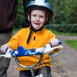 Son with father riding bike — Stock Photo