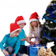Happy family unwraping christmas gifts — Stock Photo