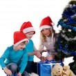 Happy family unwraping christmas gifts — Foto de Stock