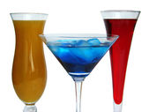 Three colorful coctail glasses on white — Stock Photo