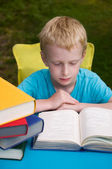 6-year old boy reading book — Stock Photo
