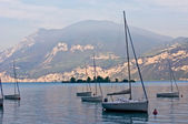Sailboats on dawn, lake Garda — Stock Photo
