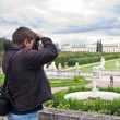 Tourist making photo in Arkhangelskoe Estate - Stock Photo