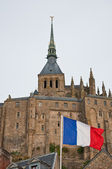 French flag in front of Mont Saint-Michel. — Stock Photo
