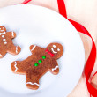 Two gingerbread men on a plate. — Stock Photo #16790519