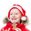 Smiling boy holding gingerbread man. — Stock Photo #16791069