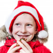 Smiling boy eating gingerbread man. — Stock Photo #16791125