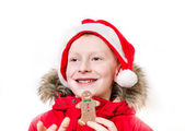 Smiling boy holding gingerbread man. — Foto de Stock