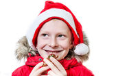 Smiling boy eating gingerbread man. — Stockfoto