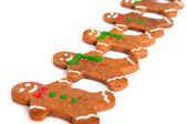 Gingerbread men in a row — Stock Photo