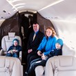 Stock Photo: Family traveling by commercial air jet