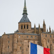 French flag in front of Mont Saint-Michel. — Stock Photo #21573853