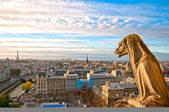 Gargoyle overlooking Paris up on Notre Dame de Paris — Stock Photo