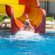 Young child sliding down a waterslide — Stock Photo
