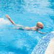 Stock Photo: Young boy swimming