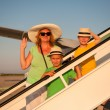 Family traveling by airplane — Stock Photo #30467599