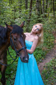 Pretty girl and a horse — Stock Photo